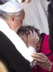 Pope kissing a sick disfigured man