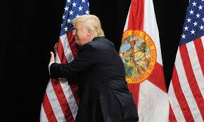 trump hugging flag